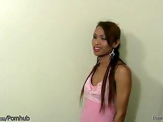 Skinny ladyboy in sexy black lingerie is posing her big cock
