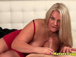 Glamour mature enjoys wanking dick