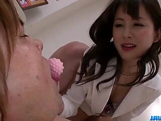 Japanese nymph dominates and sits wet hairy pussy on partner's face.