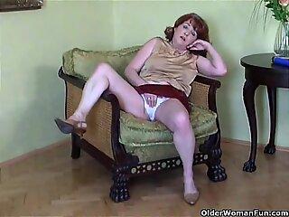 Busty mature redhead fucks dildo