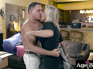 Busty hag Payton Hall moved in her new house and noticed this young stud Brad Hart and started to seduce and fuck his meaty cock.