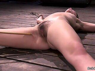 Hairy pussy babe caned in bondage