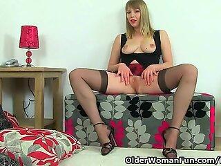 British and hard nippled milf Abi Toyne masturbates in black stockings