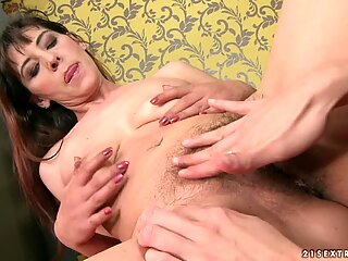 This granny loves to have her hairy cunt licked out